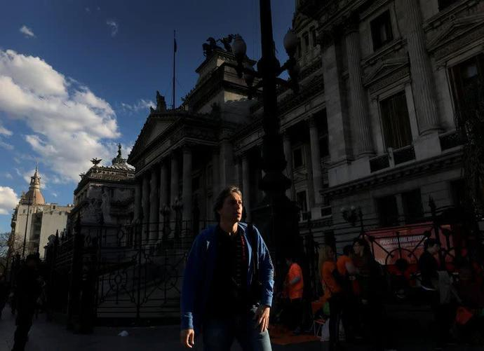 A man walks past the Congress in Buenos Aires
