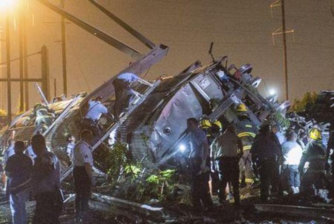 FILE PHOTO: Rescue workers search for victims in the wreckage of a derailed Amtrak train in Philadelphia
