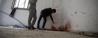 The Latest: Palestinian president condemns West Bank attack