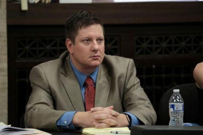 FILE PHOTO: Chicago police Officer Jason Van Dyke watches the prosecution