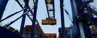 U.S. trade deficit at 1-1/2-year low; labor market strong
