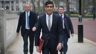 Rishi Sunak walks from the Treasury to No 11 Downing Street