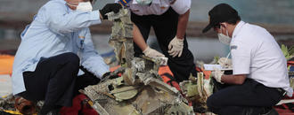 Indonesia ends search for crashed plane