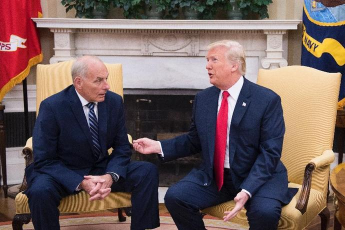 Outgoing White House Chief of Staff John Kelly, pictured with President Donald Trump in July 2017, told the Los Angeles Times that many migrants have been misled by traffickers