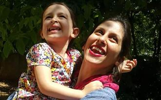 Nazanin Zaghari-Ratcliffe (R) embracing her daughter Gabriella in Damavand following her release from prison for three days - AFP