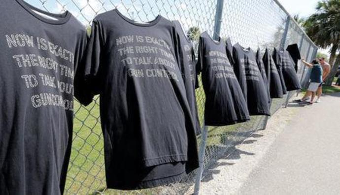 T-shirts hang on a fence near Marjory Stoneman Douglas High School in Parkland