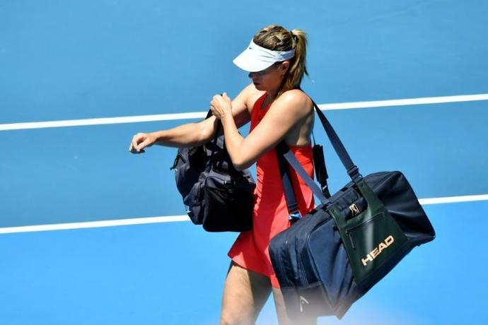 End of the road: Maria Sharapova leaves the court after her defeat to Donna Vekic at the Australian Open in January in what turned out to be her final match