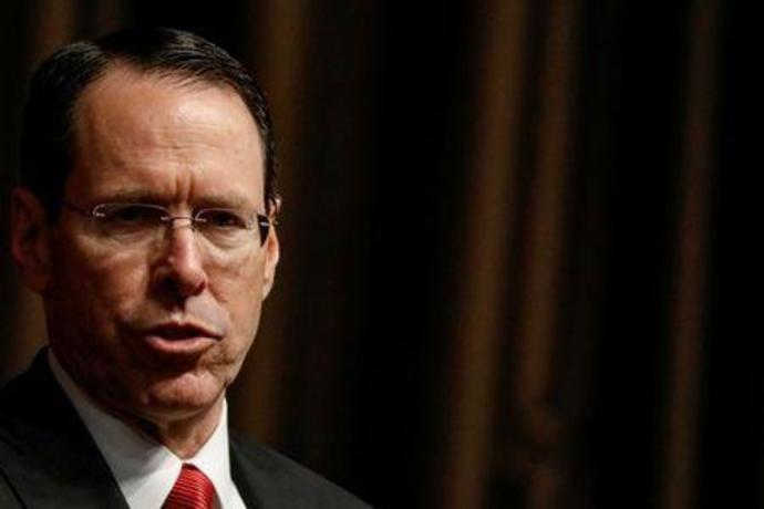 FILE PHOTO:  Chief Executive Officer of AT&T Randall Stephenson speaks during a moderated discussion before the Economic Club of New York, in New York