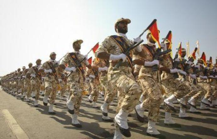Members of Iranian revolutionary guard march during parade to commemorate anniversary of Iran-Iraq war, in Tehran
