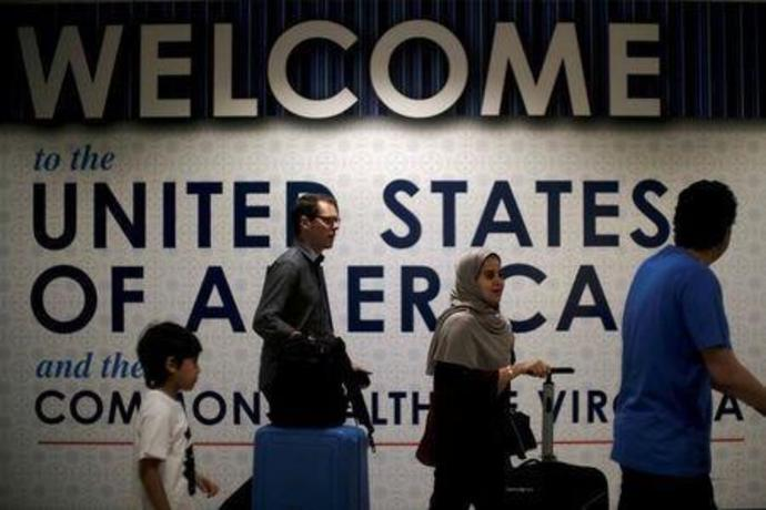 FILE PHOTO: International passengers arrive at Washington Dulles International Airport in Dulles