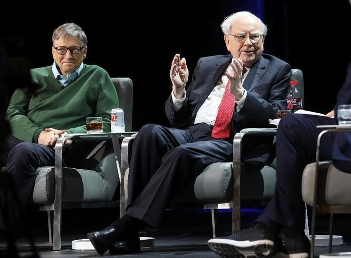 Investor Warren Buffett, seen here speaking at an event early last year in New York with fellow billionaire Bill Gates, says in his new newsletter that his company received a $29 billion bonus in 2017 thanks to a new US tax law