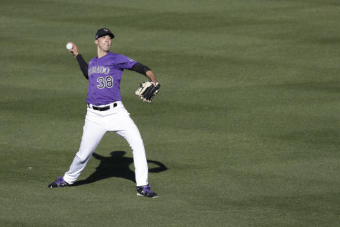Jimenez, making comeback with Rockies, solid in short outing