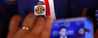The Latest: Ole Miss brings young QB to SEC media days