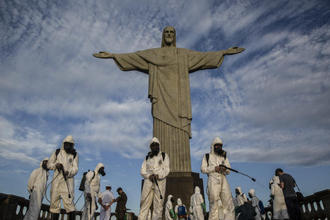 Military personnel disinfect the Christ the Redeemer monument in Rio de Janeiro on Aug.