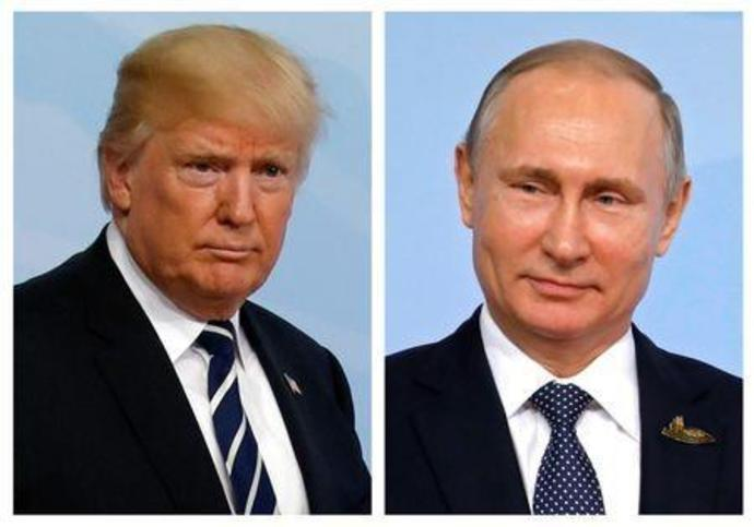 A combination of two photos shows U.S. President Trump and Russian President Putin at the G20 leaders summit in Hamburg