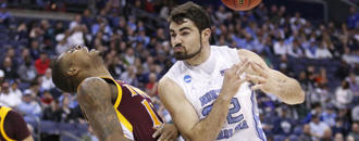 Top-seeded UNC overcomes slow 1st half to beat Iona in NCAAs