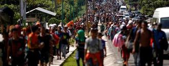 Trump vows to cut Central America aid, raises alarm on migrant caravan