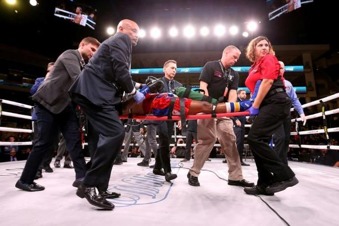 American Patrick Day is taken out of the ring on a stretcher after being knocked out in his super-welterweight bout against Charles Conwell at Wintrust Arena in Chicago