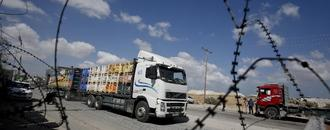 Israel reopens Gaza crossing as truce talks press on
