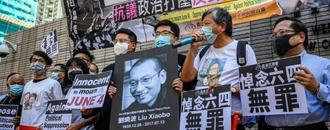 Leading Hong Kong activists charged for Tiananmen vigil gathering