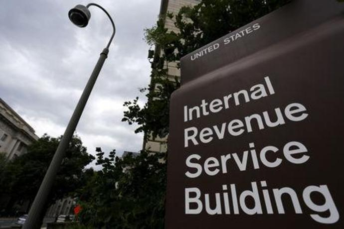 FILE PHOTO: A security camera hangs near a corner of the Internal Revenue Service (IRS) building in Washington