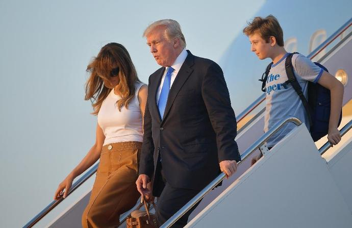 US President Donald Trump has been joned in the White House by First Lady Melania Trump and their son Barron