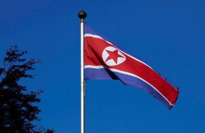 FILE PHOTO: A North Korean flag flies on a mast at the Permanent Mission of North Korea in Geneva
