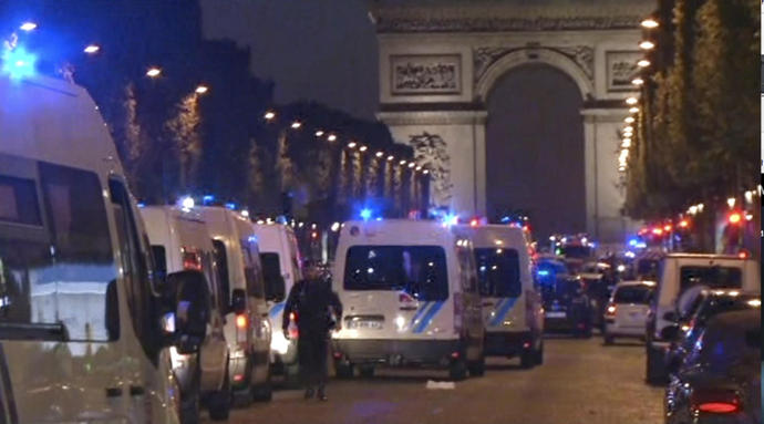 The Latest: Terror investigation opened in Paris attack