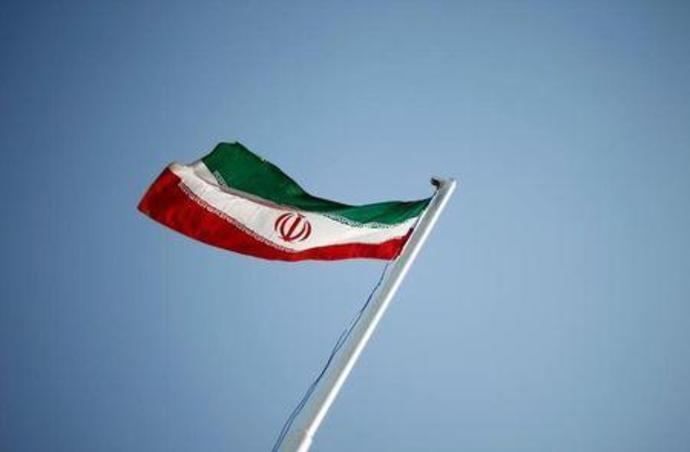 File photo of an Iranian national flag during the opening ceremony of the 16th International Oil, Gas & Petrochemical Exhibition (IOGPE) in Tehran