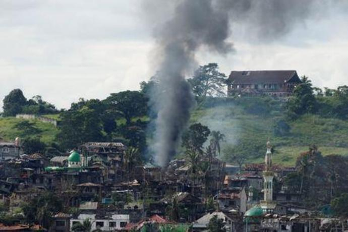 Smoke is seen following a Philippine Army airstrike as government troops continue their assault against insurgents from the Maute group in Marawi city, Philippines