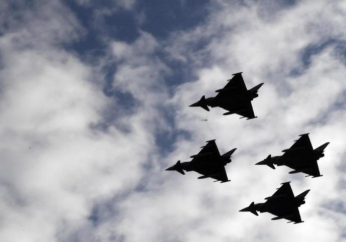 Spanish Eurofighter jets fly during the Spanish National Day military parade in Madrid on October 12, 2017