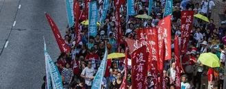Crowds rally in Hong Kong after activists jailed