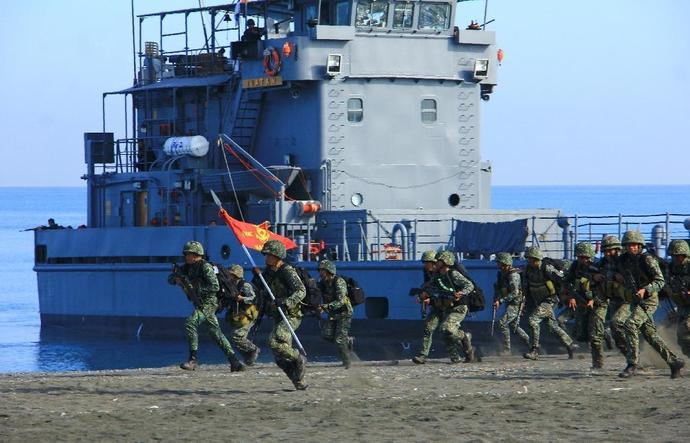 "Philippines Marines take part in a beach landing as part of the 11-day ""Balikatan"" (shoulder-to-shoulder) annual joint US and Philippine military exercises at San Jose airport in Antique province, central Philippines on April 11, 2016"
