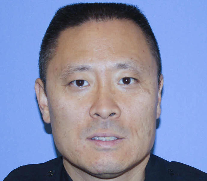 FILE - In this undated file photo provided by the Cincinnati Police Department shows Officer Sonny Kim.
