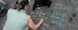 Chalked messages show Charlottesville