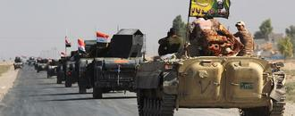 Iraqi forces drive back Kurdish fighters in independence standoff