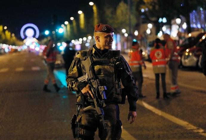 A French soldier patrols on the Champs Elysees in Paris after a shooting on April 20, 2017