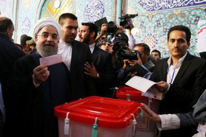 Rouhani leads Iran presidential race, expected to win: source