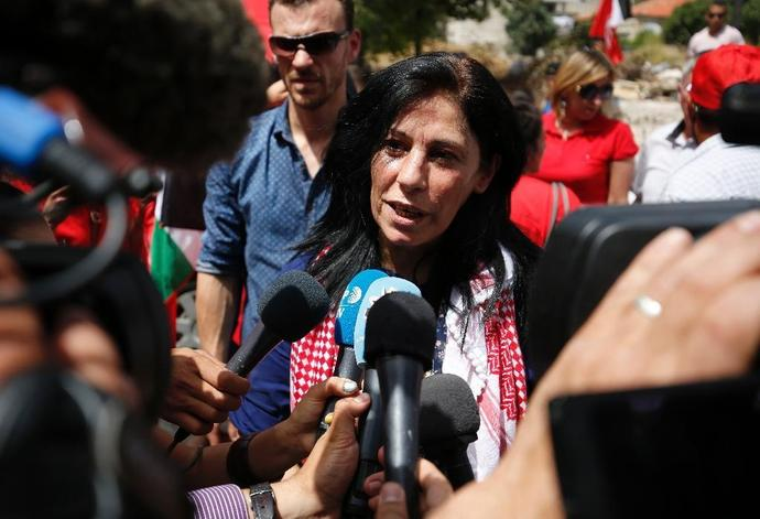 (FILES) Prominent Palestinian lawmaker Khalida Jarrar speaks to reporters in her West Bank home city of Ramallah, following her release from an Israeli jail on June 3, 2016