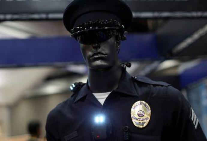 FILE PHOTO: A mannequin dressed as a police officer to show off a body camera system at a police conference in San Diego