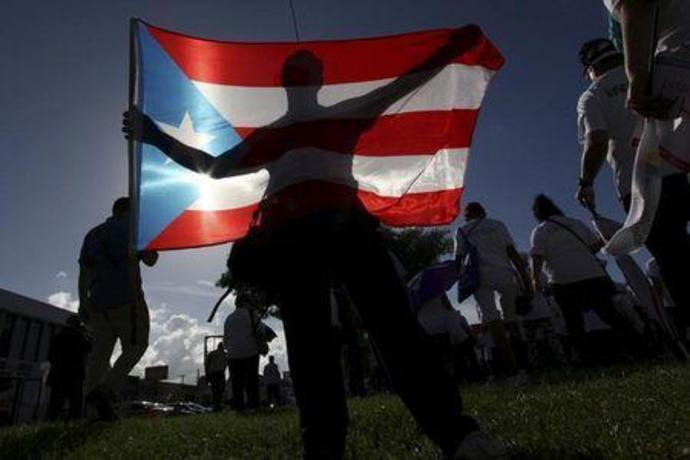 FILE PHOTO - A protester holding a Puerto Rico