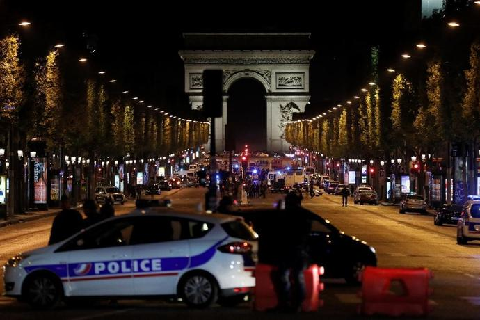 The gunman opened fire on a police van just a few hundred metres from the iconic Arc de Triomphe